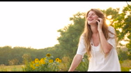 A girl sits on a bicycle and talking on the phone. Stock Footage