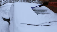 Driver Removes a Snow from the Windshield Stock Footage