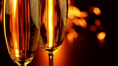 Two Glasses with Champagne and Sparkler Stock Footage