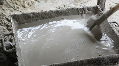 Worker mixing the cement Stock Footage