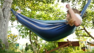 Beautiful girl lying in a hammock and makes selfie. HD Stock Footage