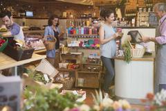 Woman at grocery store checkout Stock Photos