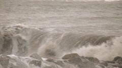 Waves crash over rocks tropical storm julia Stock Footage