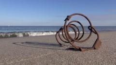 Iron spring on beach Stock Footage