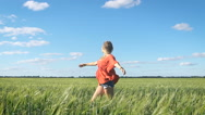 Beautiful young blond sexy woman turning around at a green field Stock Footage