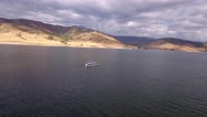 Aerial shot of boat traveling across lake Stock Footage