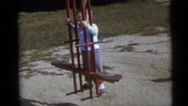 1967: kids swinging in different swings in a children's park CAMDEN, NEW JERSEY Stock Footage