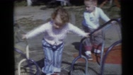 1956: two kids enjoying a revolving ride in a park FLORIDA Stock Footage