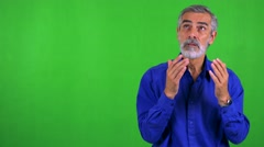 Old senior man is suprised - green screen - studio Stock Footage