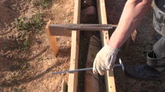 Builder cementing foundation Stock Footage