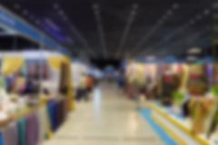 People shopping in exhibition trade fair - blur Stock Photos