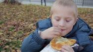 Eat autumn boy Stock Footage