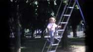 1956: little girl climbs up to the top of slide on playground FLORIDA Stock Footage