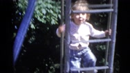 1967: little girl makes faces and climbs on a slide CAMDEN, NEW JERSEY Stock Footage