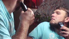Man shaves off his beard Stock Footage