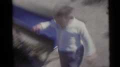 1956: funny boys running in the kids park around the rides FLORIDA Stock Footage