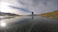 Skating on the frozen lake - Mountain lake Stock Footage
