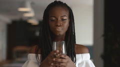 Young beautiful african american female fashion model holding wineglass in her Stock Footage