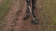 Man using Metal Detector on a Field Road Stock Footage