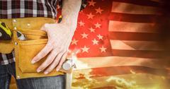 Composite image of handyman wearing tool belt Stock Photos