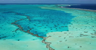 Aerial view of coral reef lagoon in South Pacific Stock Footage