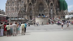 Tourist group in front of Sagrada Familia Stock Footage