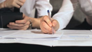 Businessman signs a document at work Stock Footage