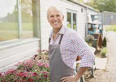 Portrait smiling plant nursery small business owner Kuvituskuvat