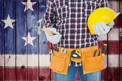 Composite image of handyman holding hard hat and hammer Stock Photos