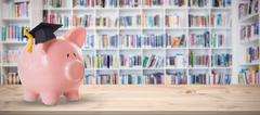 Composite image of piggy bank with graduation hat Stock Photos