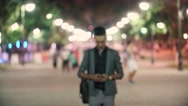 Successful young Eastern man to walk on night city, a public place, have a Stock Footage