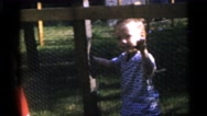1967: kids behind a fence. CAMDEN, NEW JERSEY Stock Footage