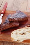 Beef meat steak on wood with whiskey Stock Photos