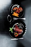 Beef meat steak barbecue garnished  with vegetable salad sweet p Stock Photos