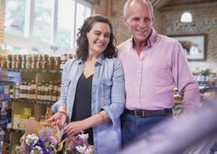 Smiling couple shopping in market Stock Photos