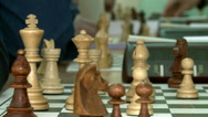 A chess tournament.Black and white chess pieces.Panorama. Stock Footage