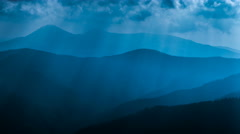 The beautiful mountain view on the background of moonlight fog beam.Time lapse Stock Footage