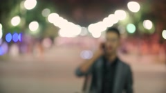 Young successful Manager, night city, a public place, emotionally speaking on Stock Footage