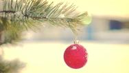 Red Christmas ball hanging on fir tree seamless loop 4k UHD (3840x2160) Stock Footage