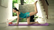 Young, pretty woman lifting legs on mat in luxury villa, 4K Stock Footage