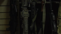 Machines are in the studio near the wall. Weapons on the stand. Various military Stock Footage