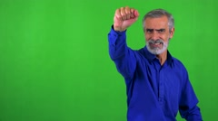 Old senior man is angry (protest) - green screen - studio Stock Footage