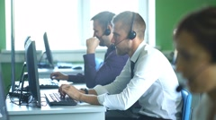 Two men working in the center of the number operators Stock Footage