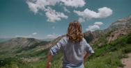 Successful woman raising hands on the top of mountain Stock Footage