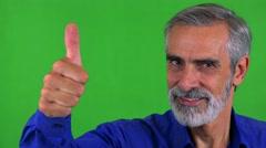 Old senior man shows thumb up on agreement - green screen - studio - closeup Stock Footage