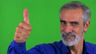 Old senior man shows thumb up on agreement - green screen - studio - closeup Stock Footage