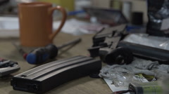 The table with tools. Place in a workshop for repair of weapons. Broken clips Stock Footage