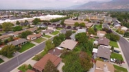 Aerial shot of houses in mountain city suburb Stock Footage