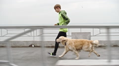 Sporty Boy Jogging with Dog Stock Footage