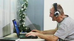 Man using laptop computer at home. Stock Footage